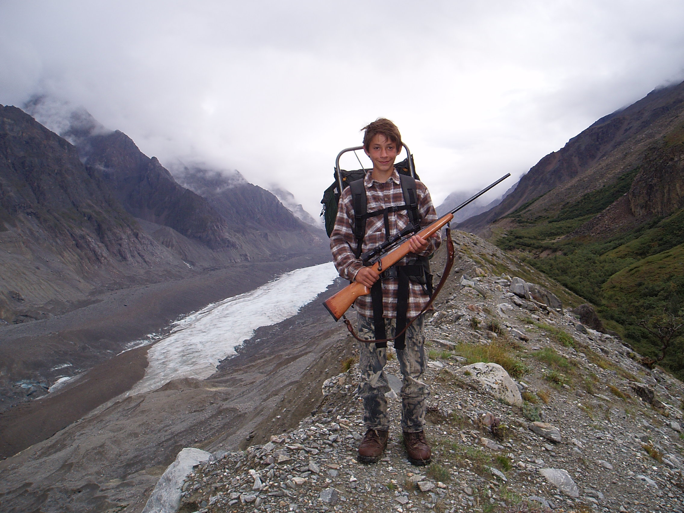 The sheep hunter. Jared on his first sheep hunt after sleeping out without a sleeping bag, ready for the long walk out.