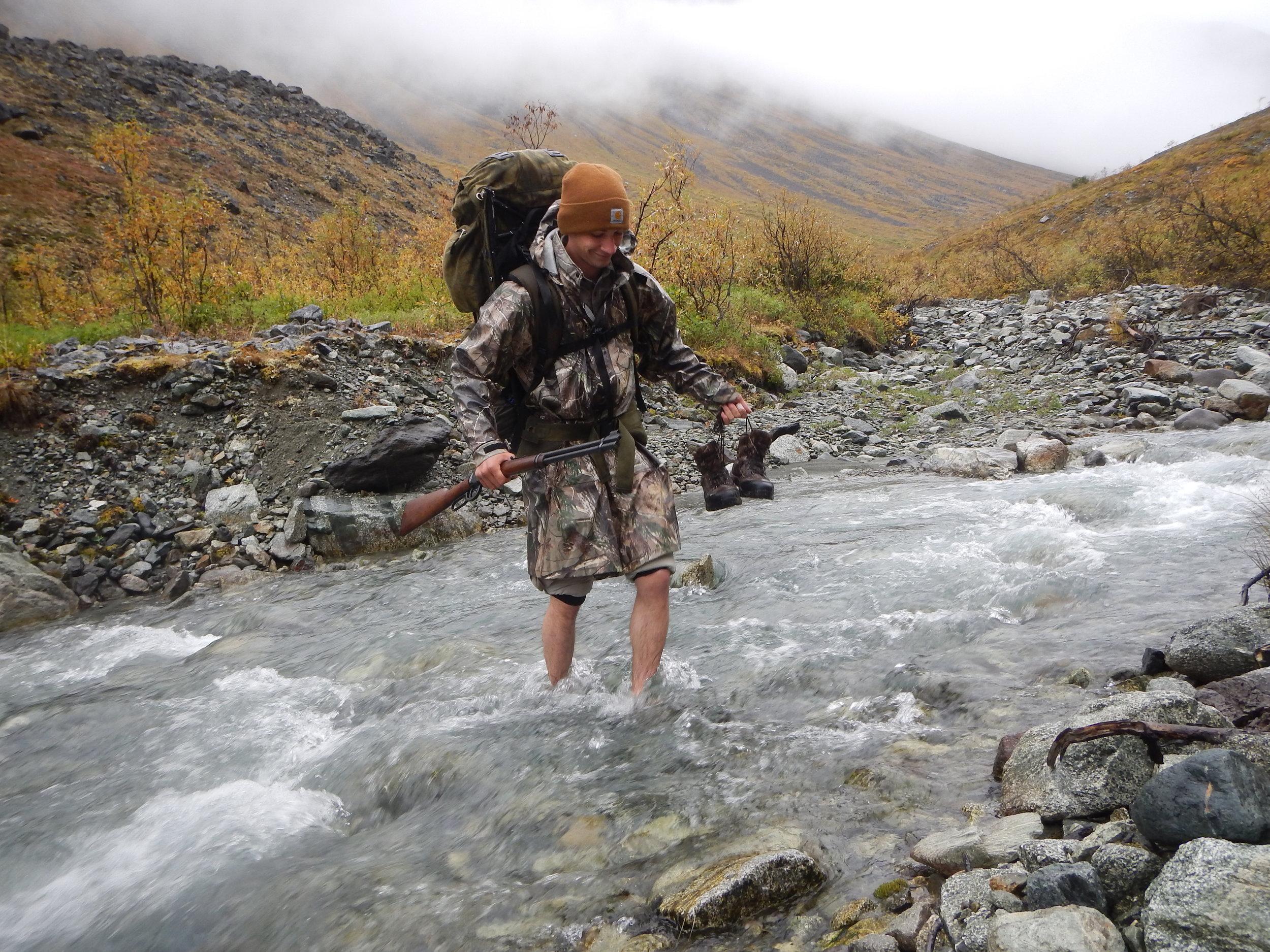 Jared crossing the creek.