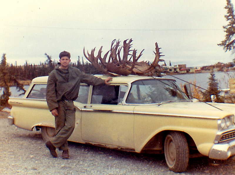 Me and my 59 Ford Station Wagon loaded with two moose and three caribou. Lake Louise is in the background.