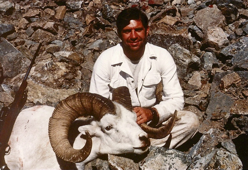 "A happy sheep hunter with his beautiful 40"" ram."