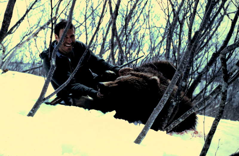 """Doug with his 7'8"""" brown bear taken at Chignik Lake. It was traveling in the snow."""
