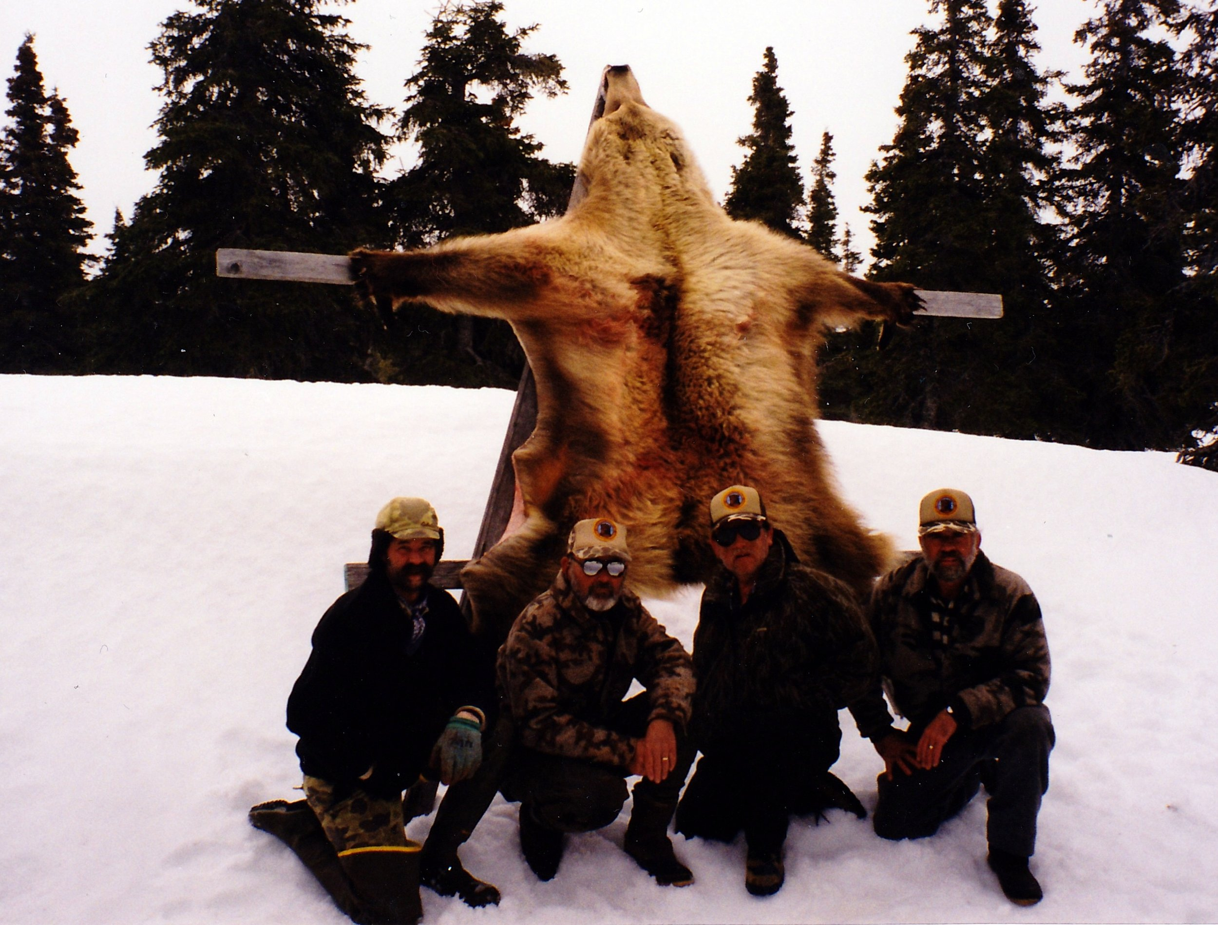 """1999, (L to R) Guide John Koldeway, Dan, """"Wild Bill"""" Lee, Hanover, PA and myself. When Wild Bill got back to Anchorage he was in one of the local bars and was bragging about his beautiful """"Blond"""" bear and when he returned to his rental car the bear had been stolen. Not good! Unfortunately, the bear was never recovered."""