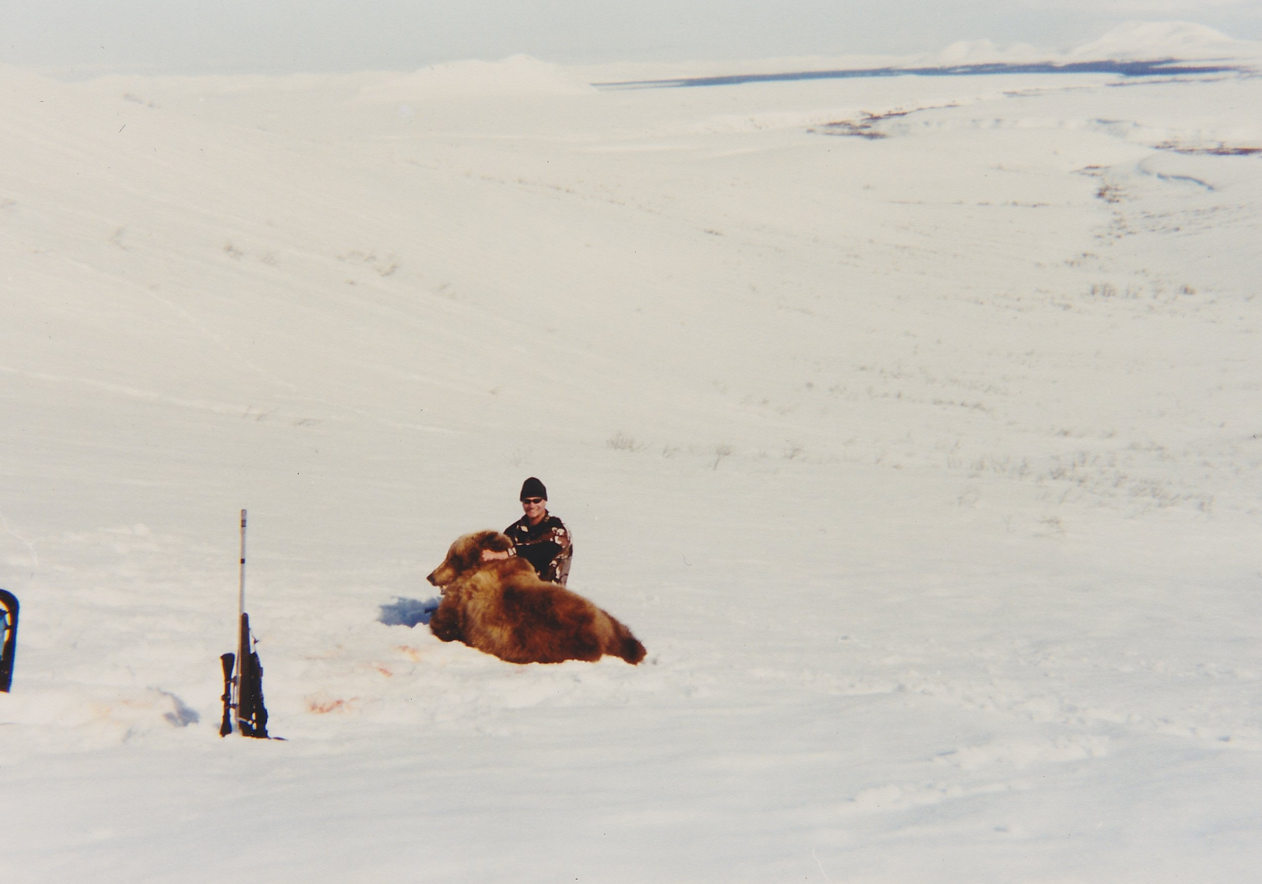 Guide Mark Glaser with Ken Farrier's bear. Typical snow conditions.