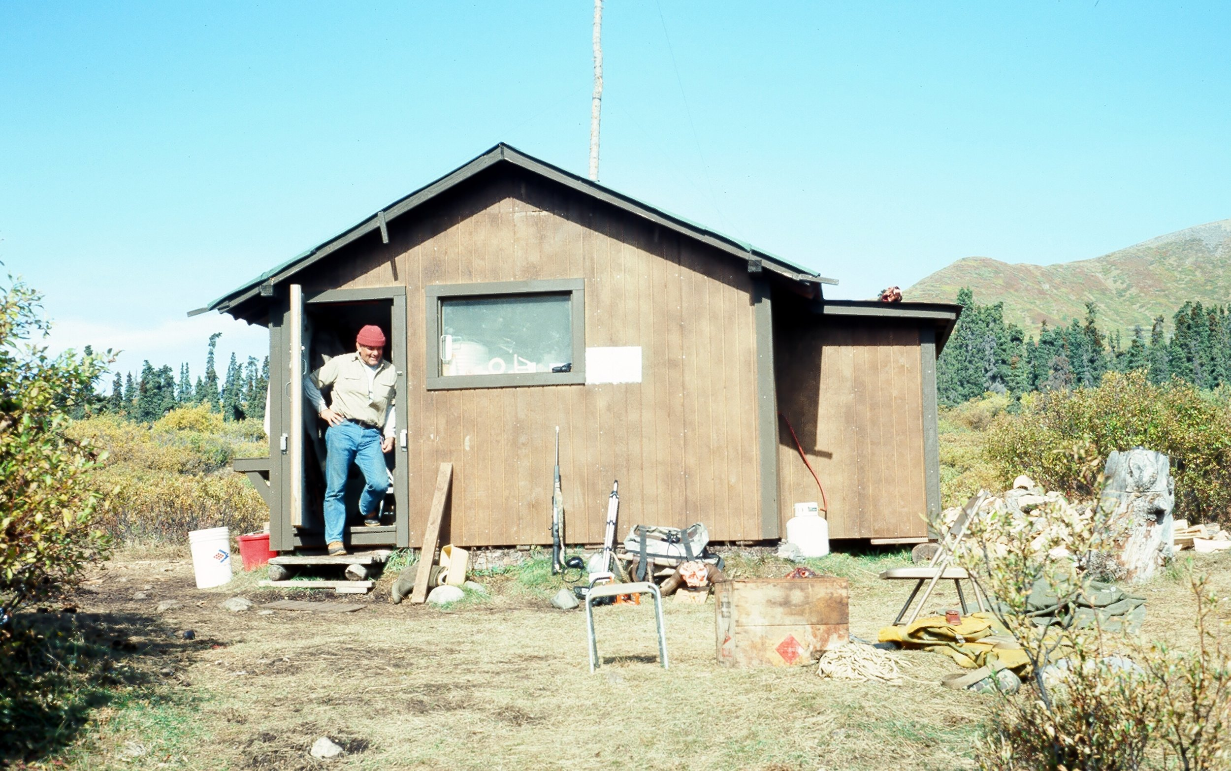 George Snyder in the doorway of our Big Bend Lakes Cabin.