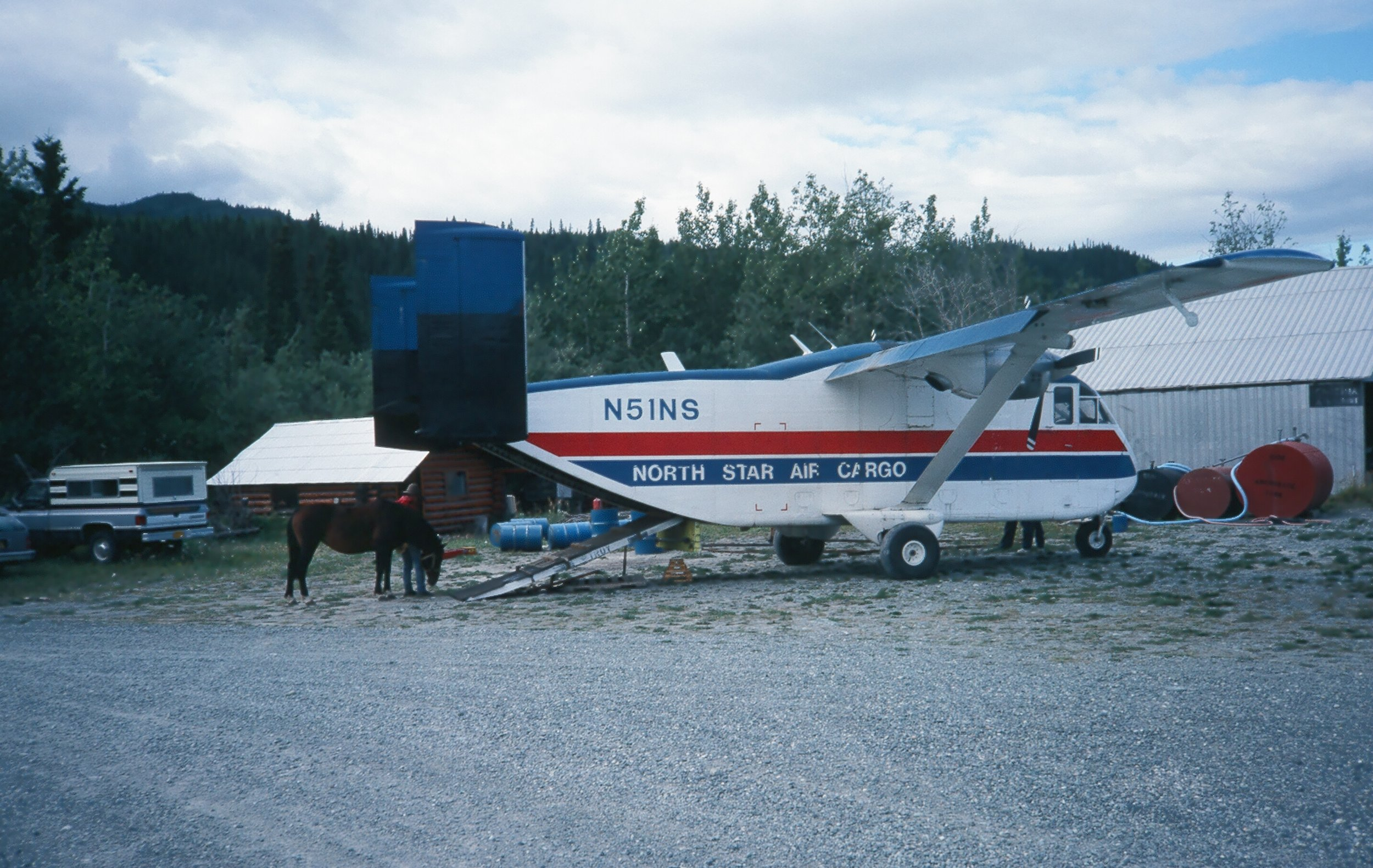 """Loading the horses in the """"Skyvan"""" at the Chitina runway."""
