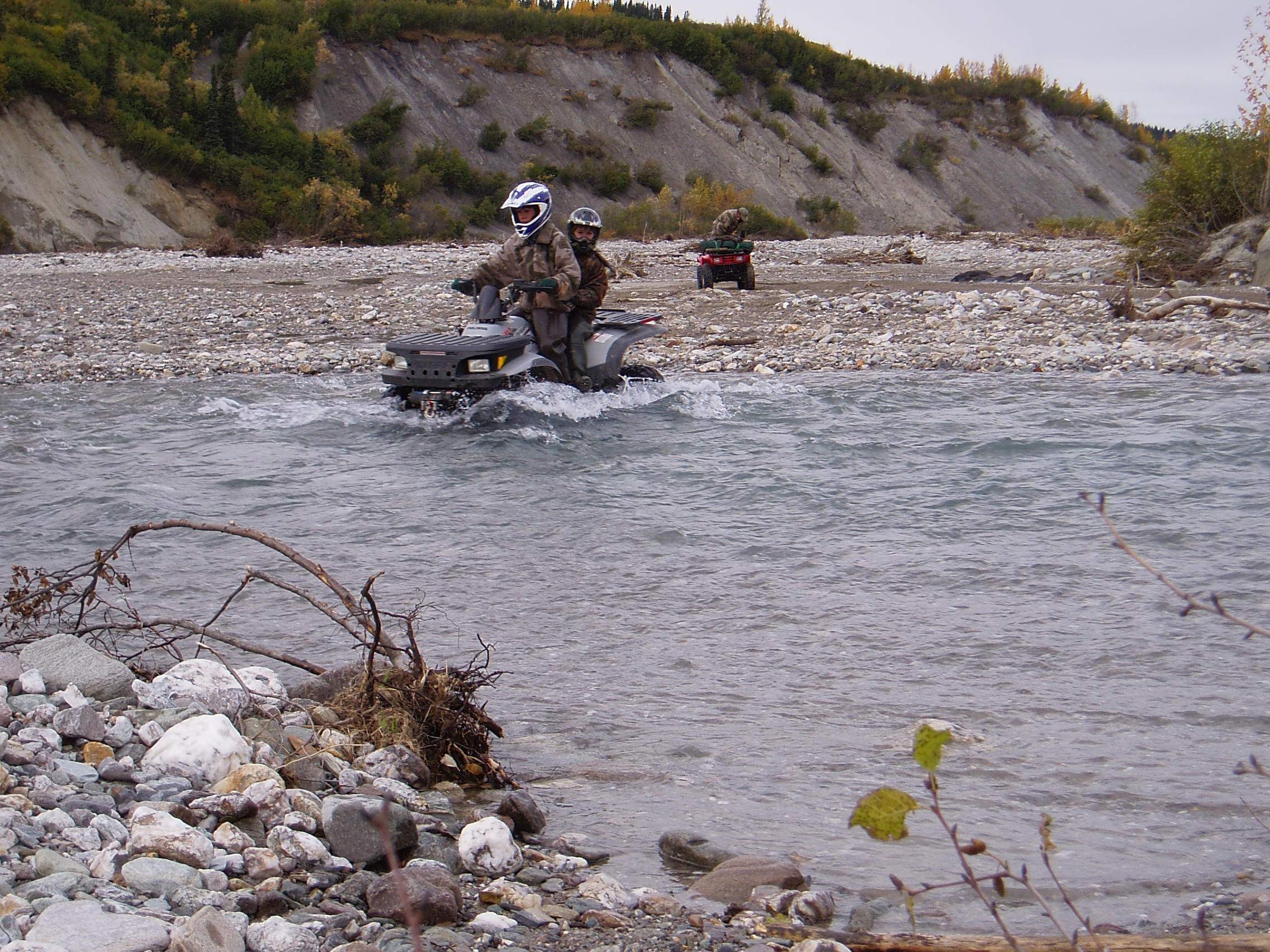 Jared and Nathan riding double on a normal creek crossing. Sagen is in the background.