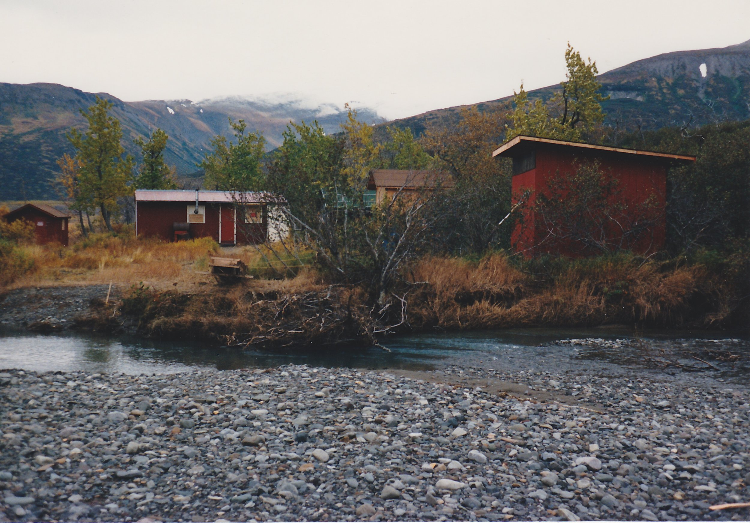 The Dog Salmon River camp in the summer of 1989.  This photo shows the small channel between the cabin and the runway.