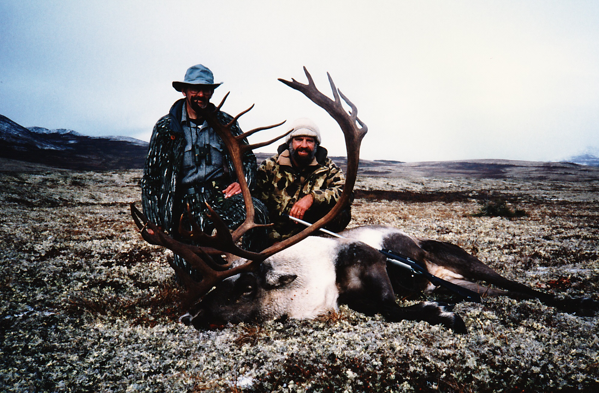 """Rich Portis of NC and me with his long beamed double shovel caribou scoring 404 B&C points. He shot his caribou beside our runway at Otter Lake. I tell everyone we hid behind the 30"""" Air Streaks on our """"Super Cub"""" during the stalk."""