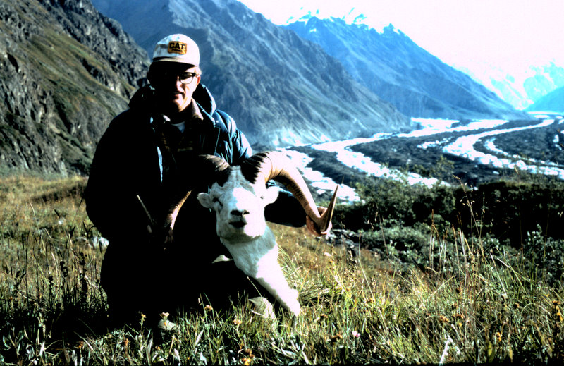"""Brent in the field where we camped with his 40"""" ram. The area in the far background is where Dick and I hunted."""