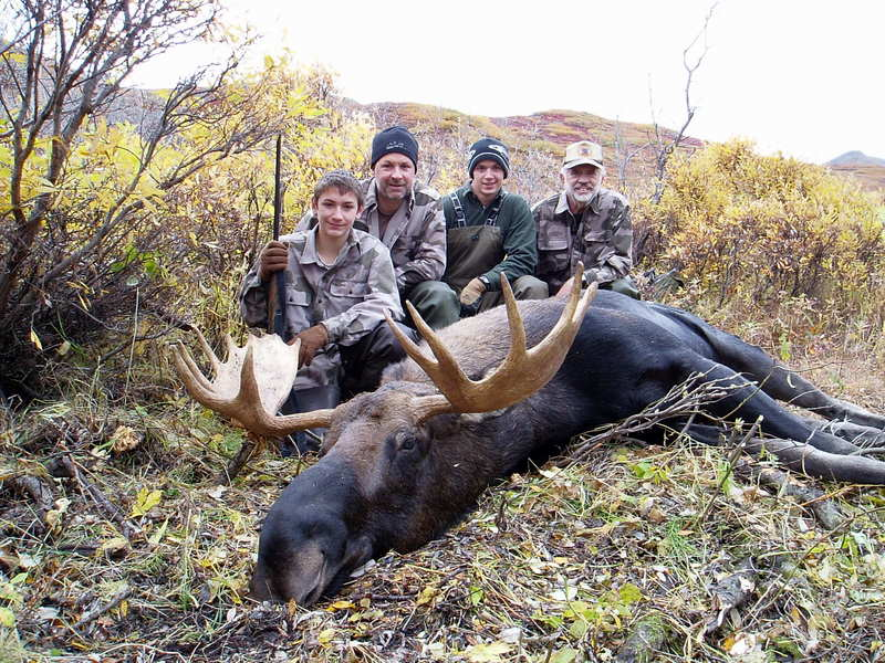 """(L to R) Nathan, Sagen, Jens and me with Nathan's 46"""" moose. Now the work begins."""