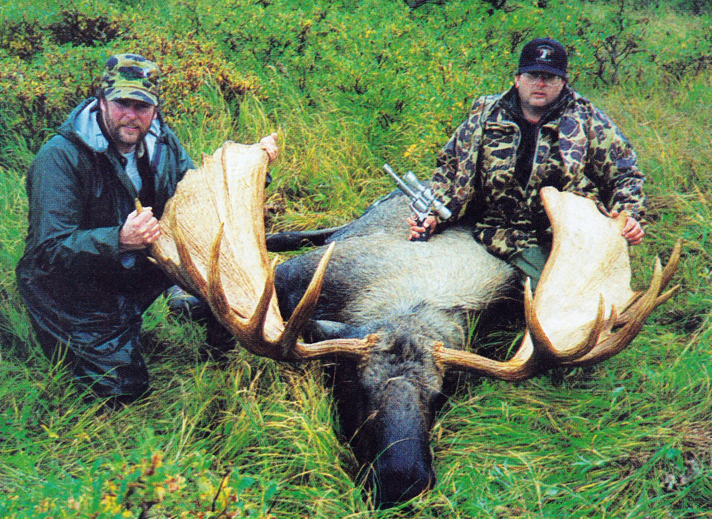 """(R to L) Roy Joblonski, NJ, and guide Brent Hudson with Roy's 71 1/2"""" spread moose that he took with his pistol. It was taken in '92 on the Alaska Peninsula."""