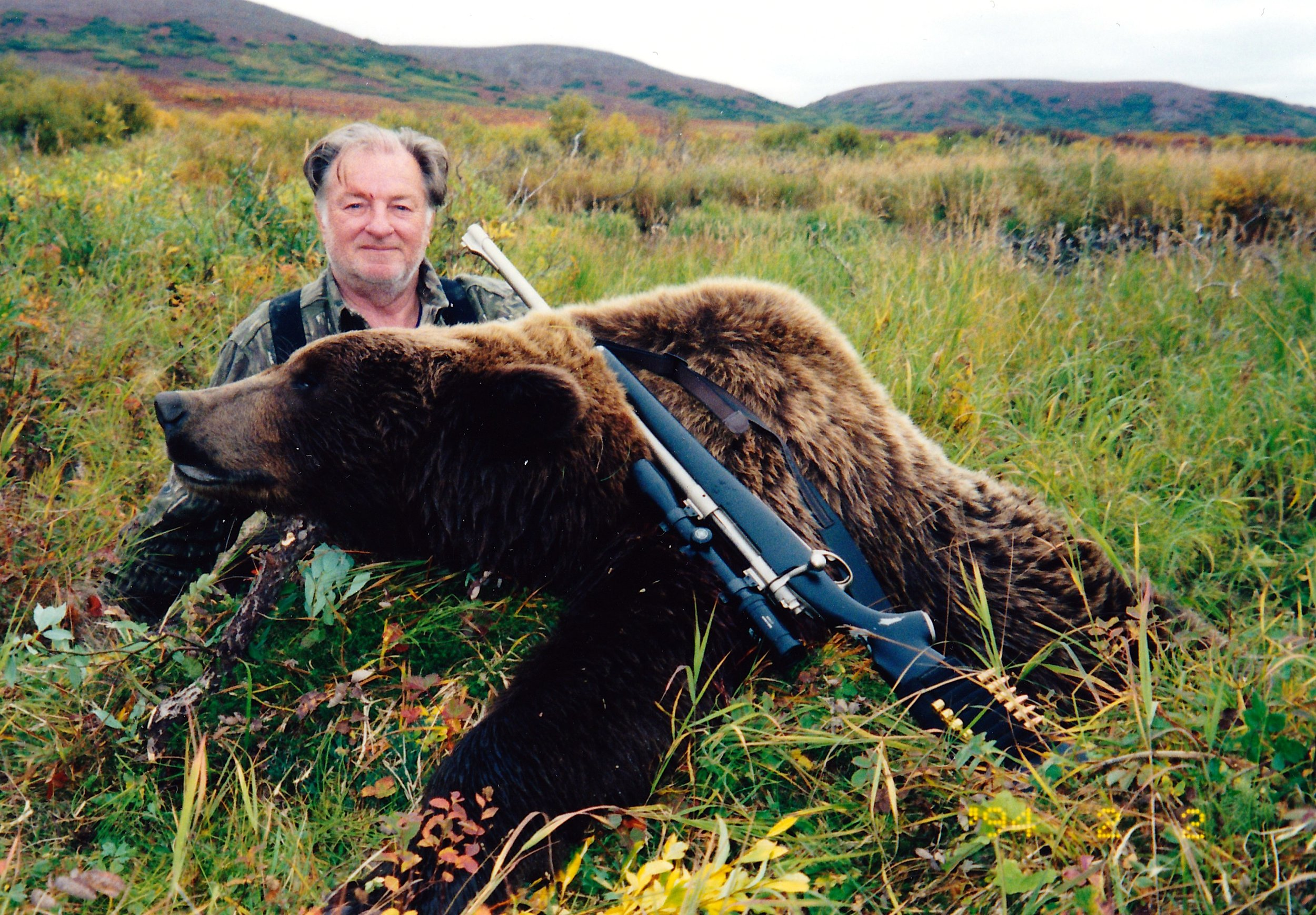 "Tom Clinton, IL, with his 8' grizzly.  This was Mik's last client at ""Mik's Place."""