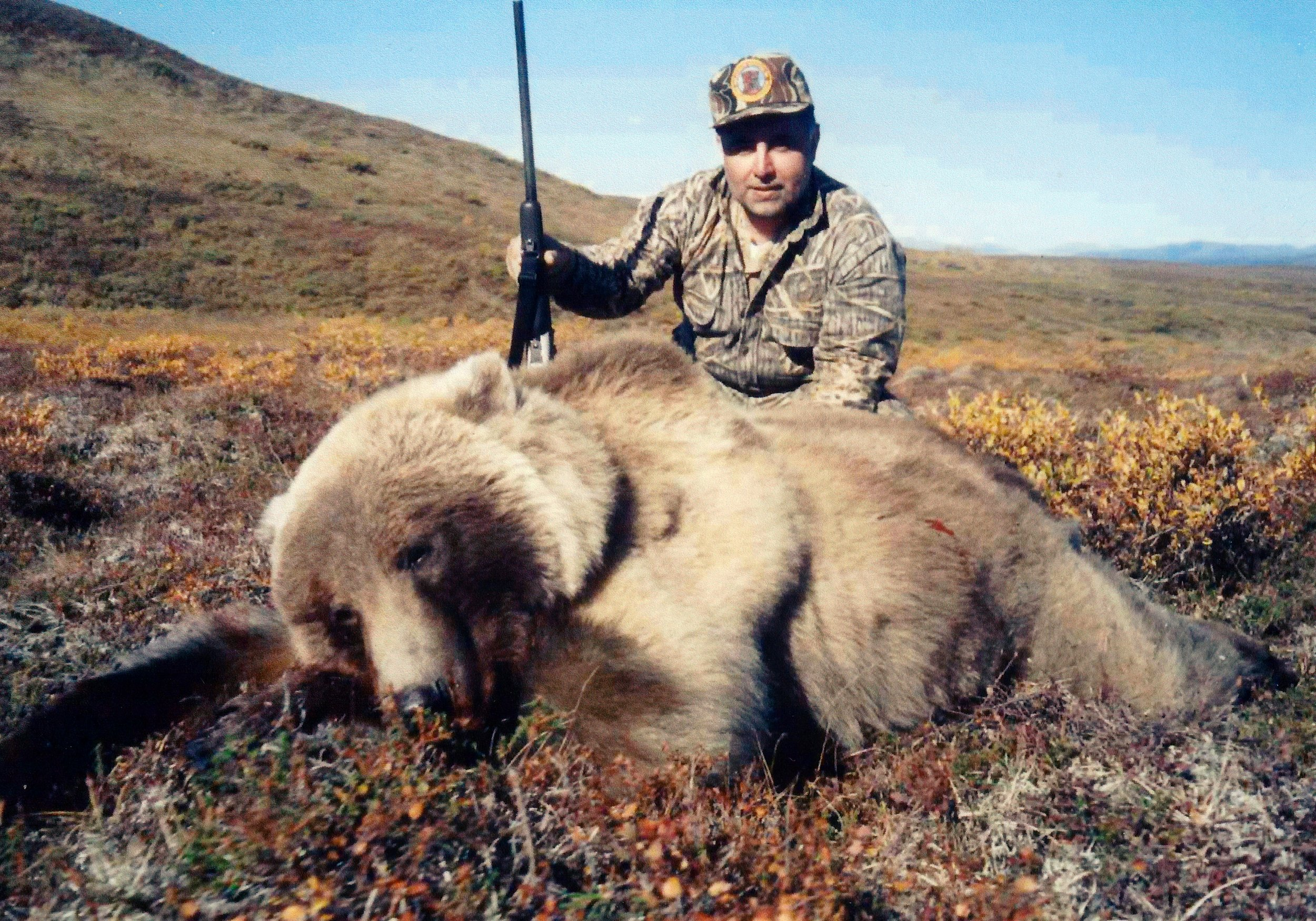 "Tugrul Selek, Istanbul, Turkey, with his beautiful 8' grizzly.  Tugrul was Steve's last hunter at ""Mik's Place"" in 2003.  Unfortunately, Steve had to leave due to a family emergency, so John Koldeway guided Tugrul for the remainder of his hunt.  My family and I got to visit with Tugrul and his wife Giacomina in Turkey a few years ago.  They were gracious hosts."