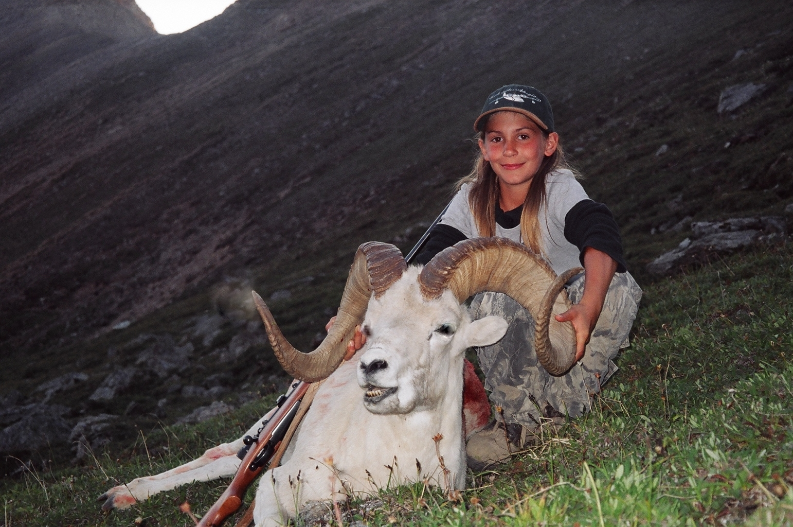 """The huntress"" with her ram.  I love this photo."