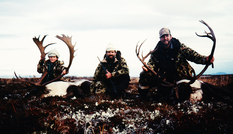 (L to R) Frank, age 9, myself and Tim with two trophy caribou. What fun!