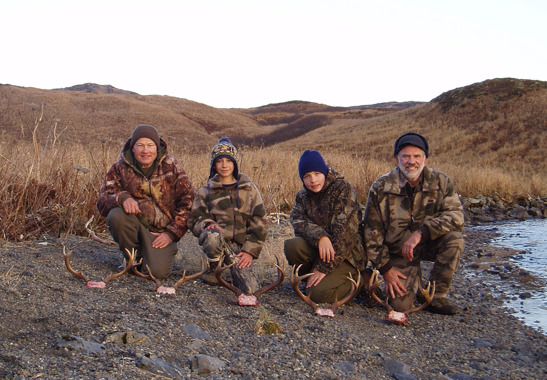 A great deer hunt on the south end of Kodiak. (L to R) Ron Watts, grandson Jared, Ron's son Philip and me.