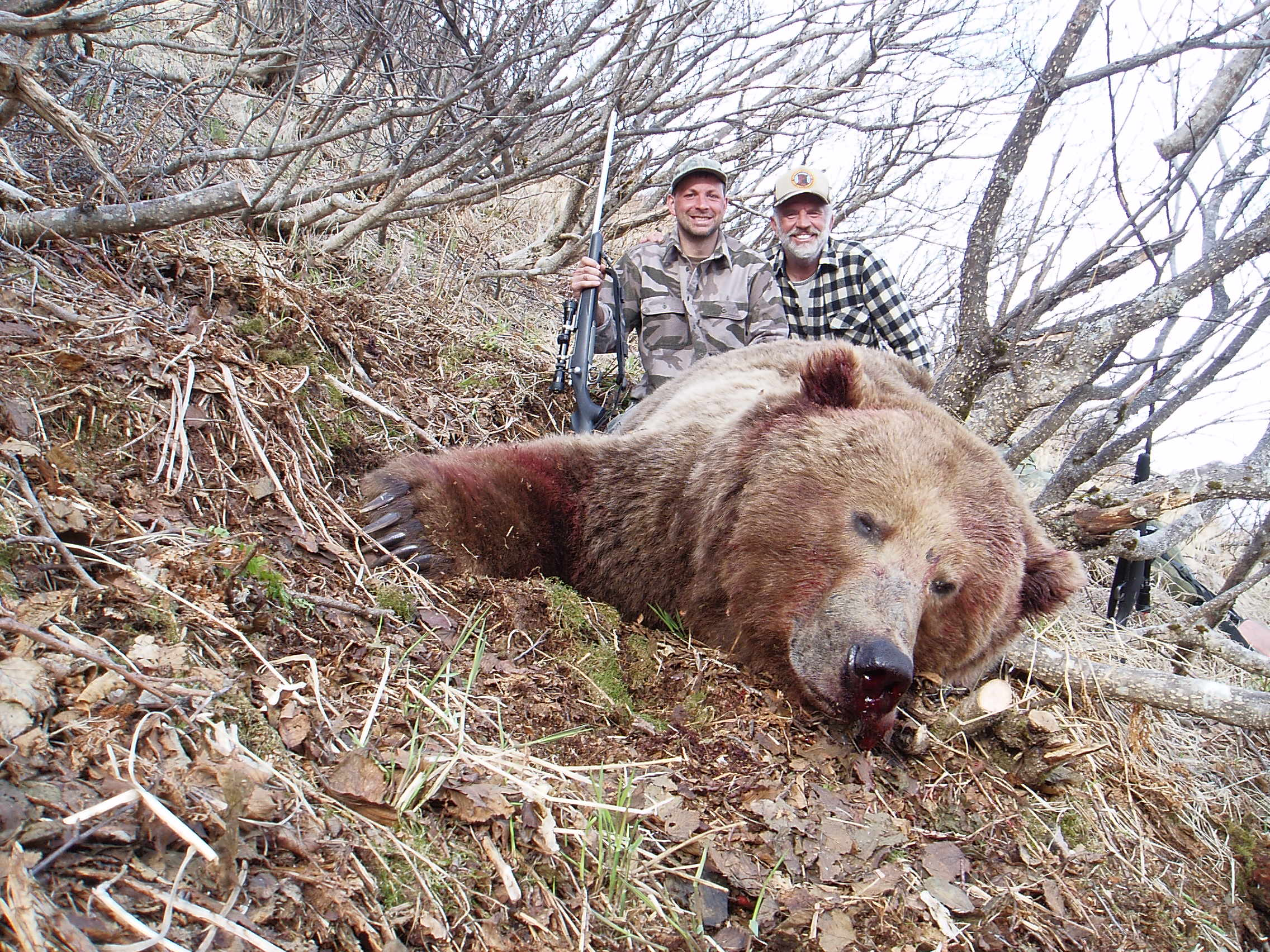 """Sagen and me with his 10'1"""" brown bear."""