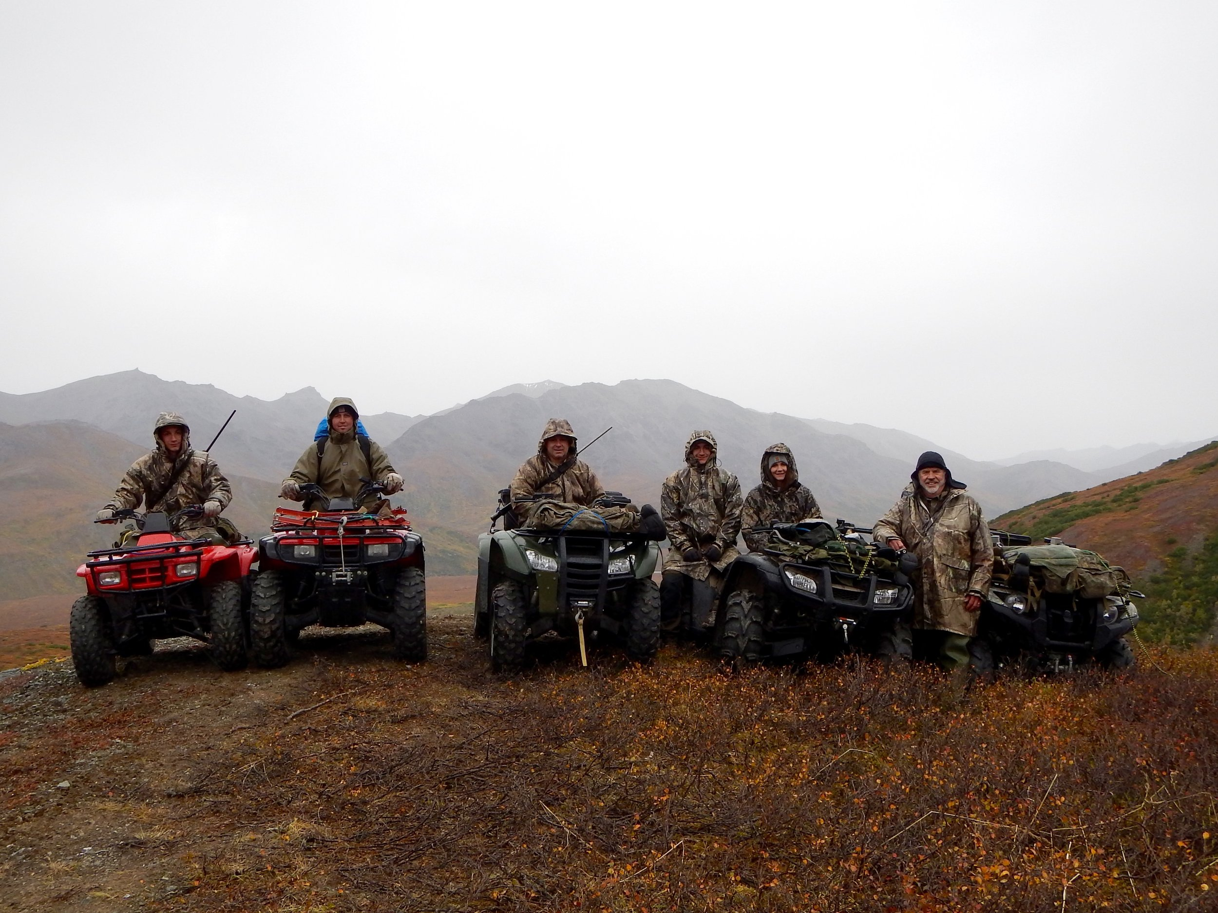 With rain showers in the background we are headed off the mountain. (L to R) Jared, Nate, Sagen, Nathan, Rachel and yours truly.