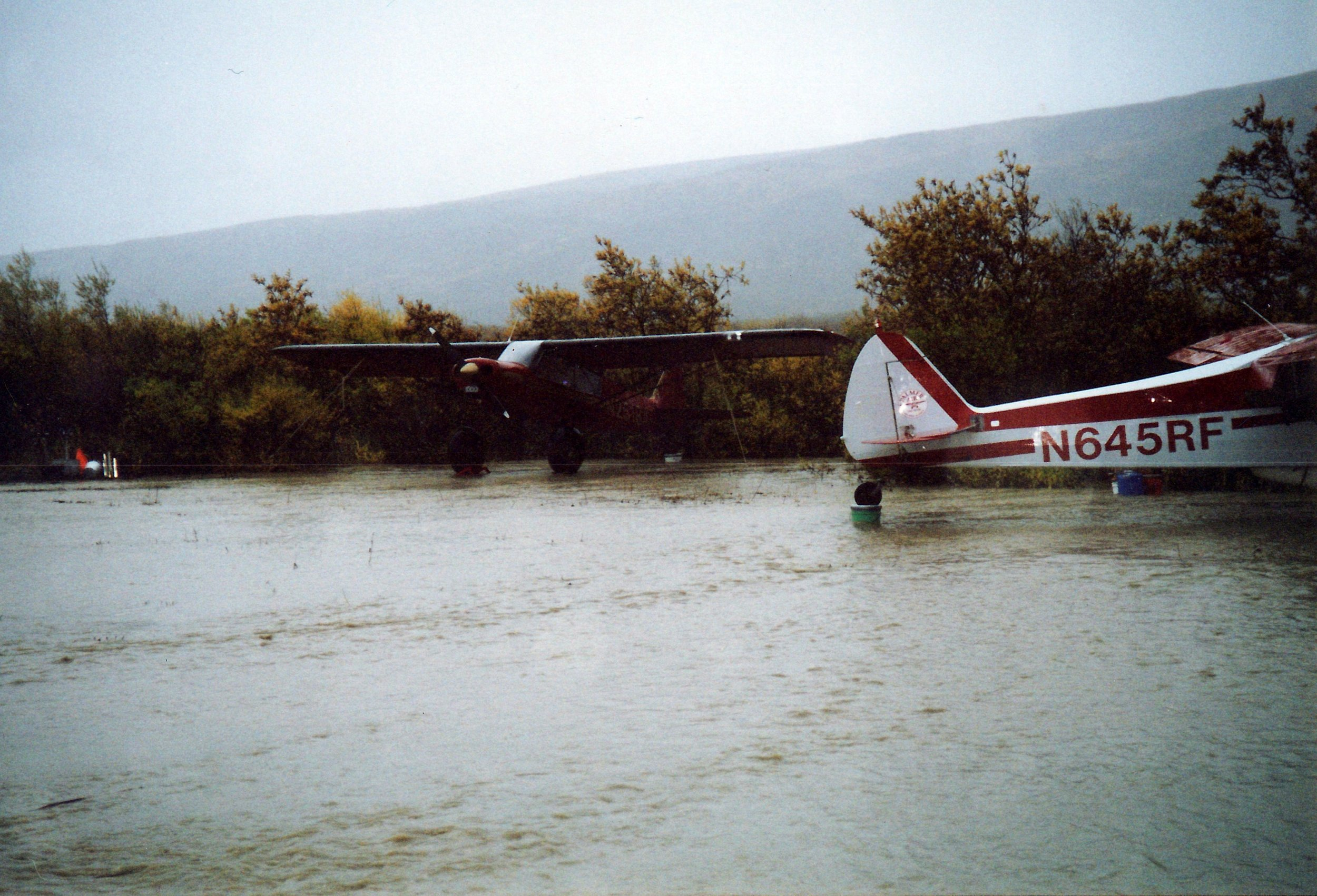 Planes on crates and buckets during one of the Dog Salmon River floods.