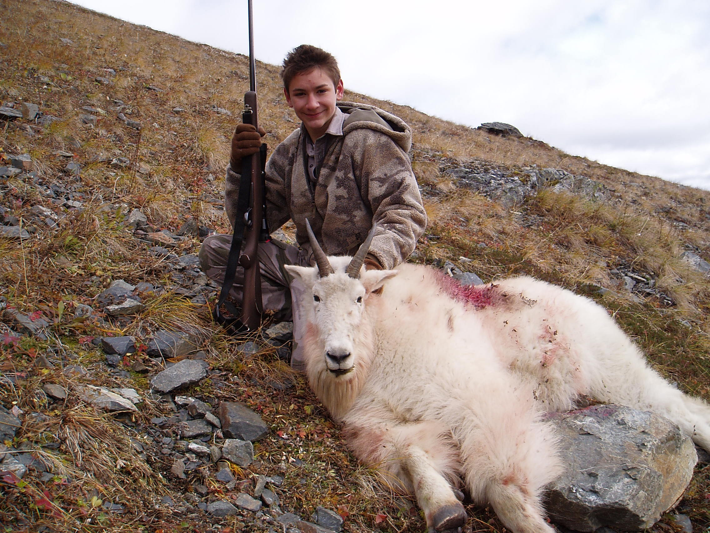 Nathan with his goat. A proud hunter.