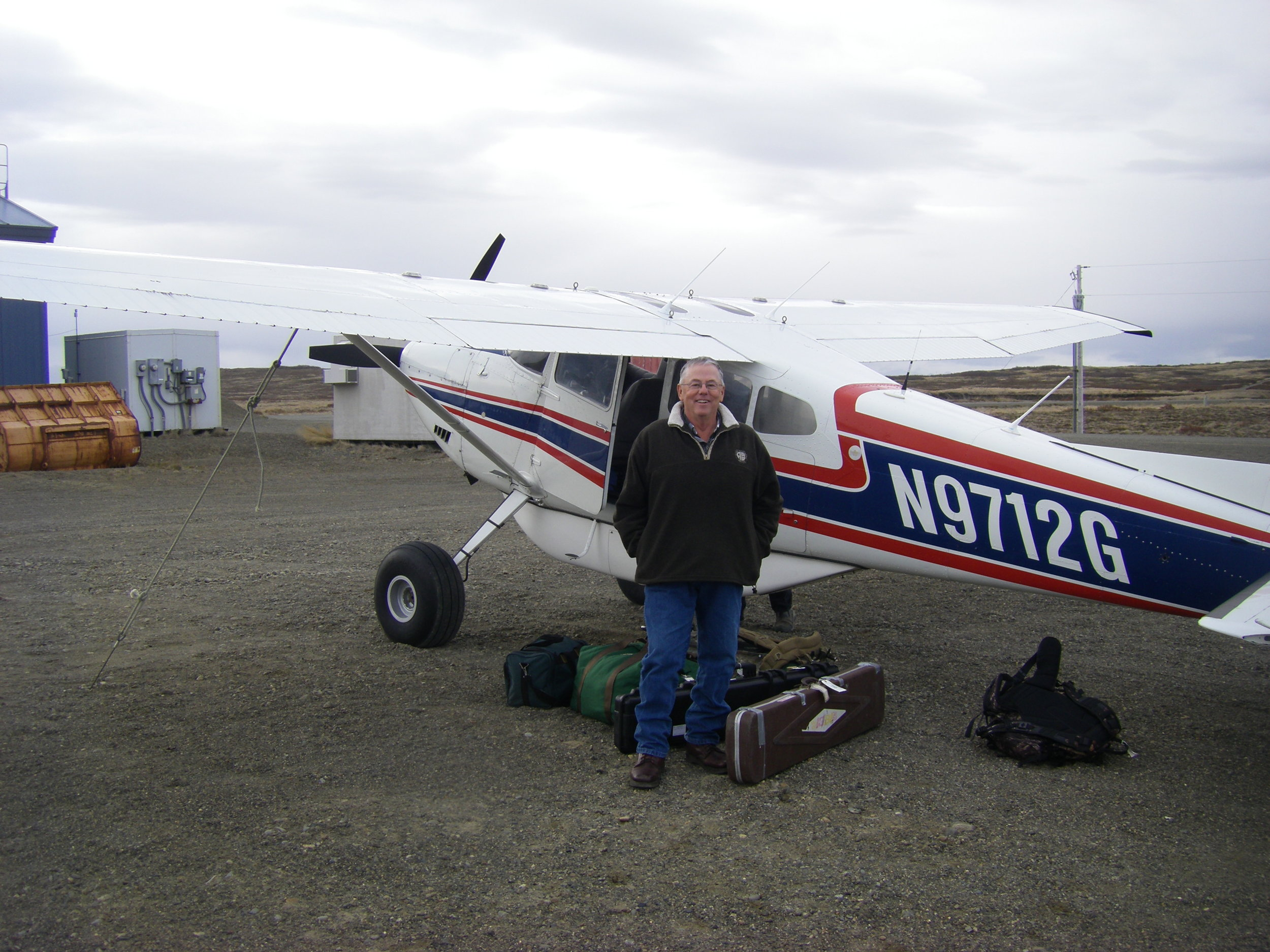 Matt at Pilot Point getting our gear ready to load into Rick's Cessna 185.