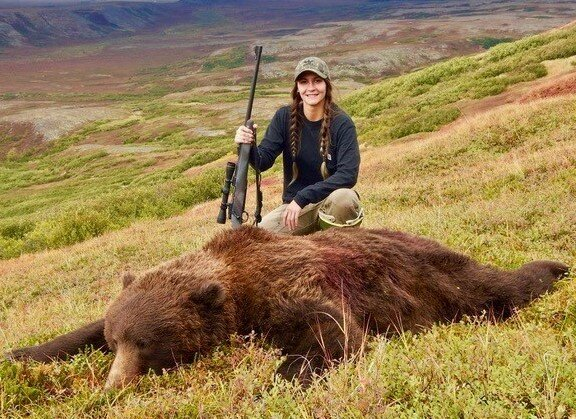 "Rachel with her beautiful 8'8"" brown bear. Gorgeous country."