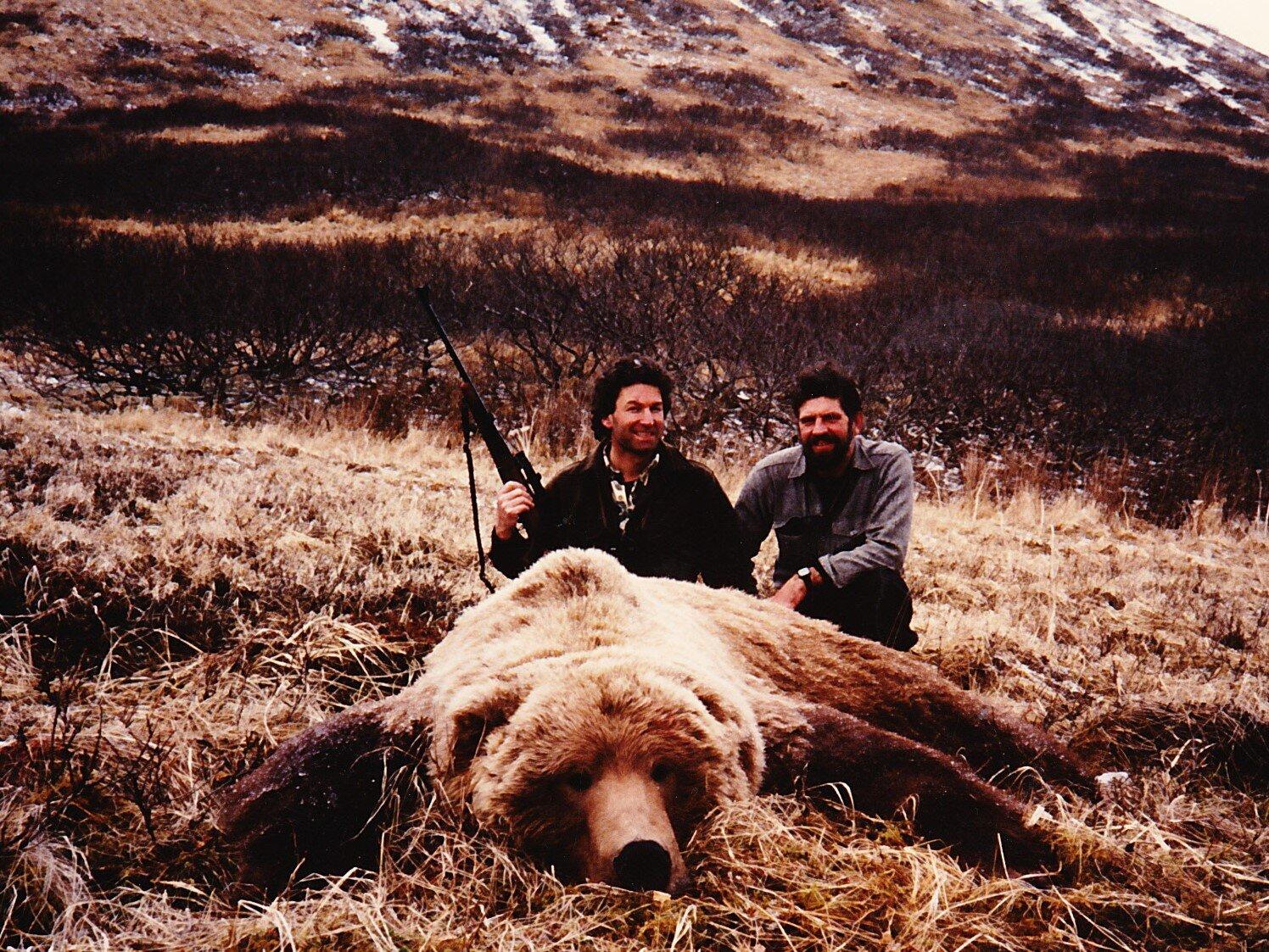 "Karl Kliem with his beautiful 9'5"" brown bear taken the spring of '86."