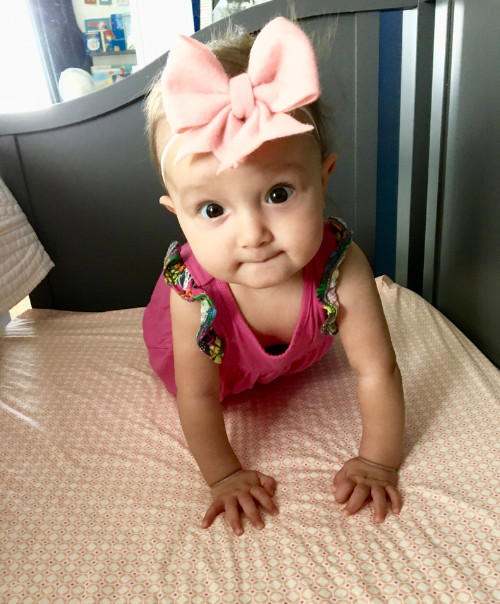 """Hanging out in the crib wearing a Lilly Belle Market 4"""" pale pink Lucy felt bow."""
