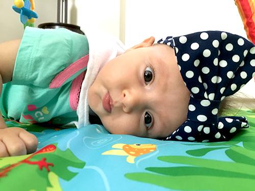 Navy and white polka dot baby turban headband from Posh Pelican Co.
