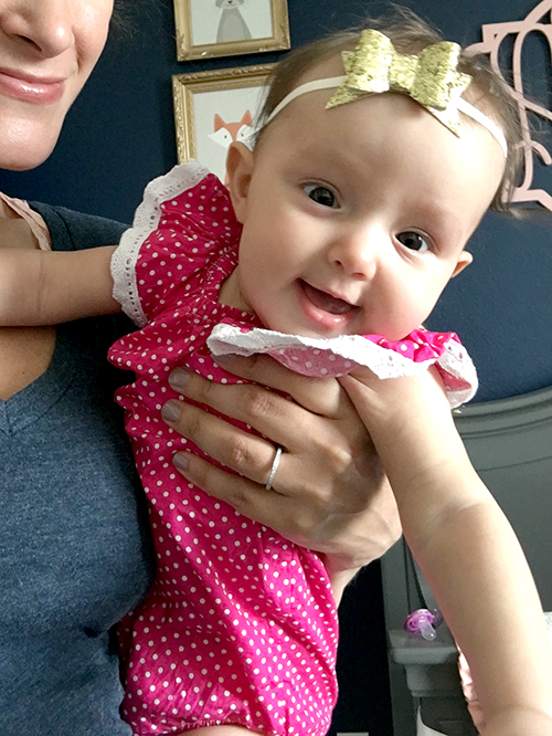 Happy to be held by Mommy and to be wearing my glitter bow by Maddie & Bean