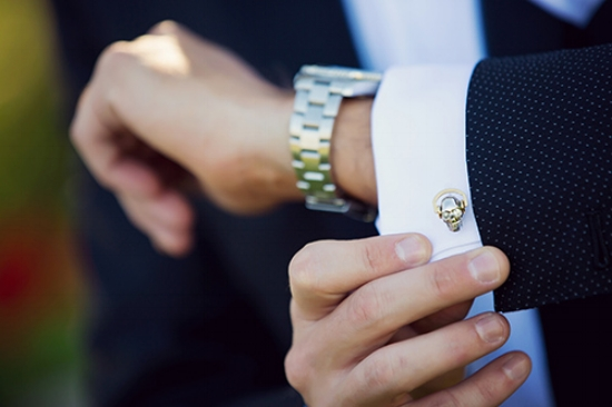 Skull cufflinks. A staple in this man's closet!