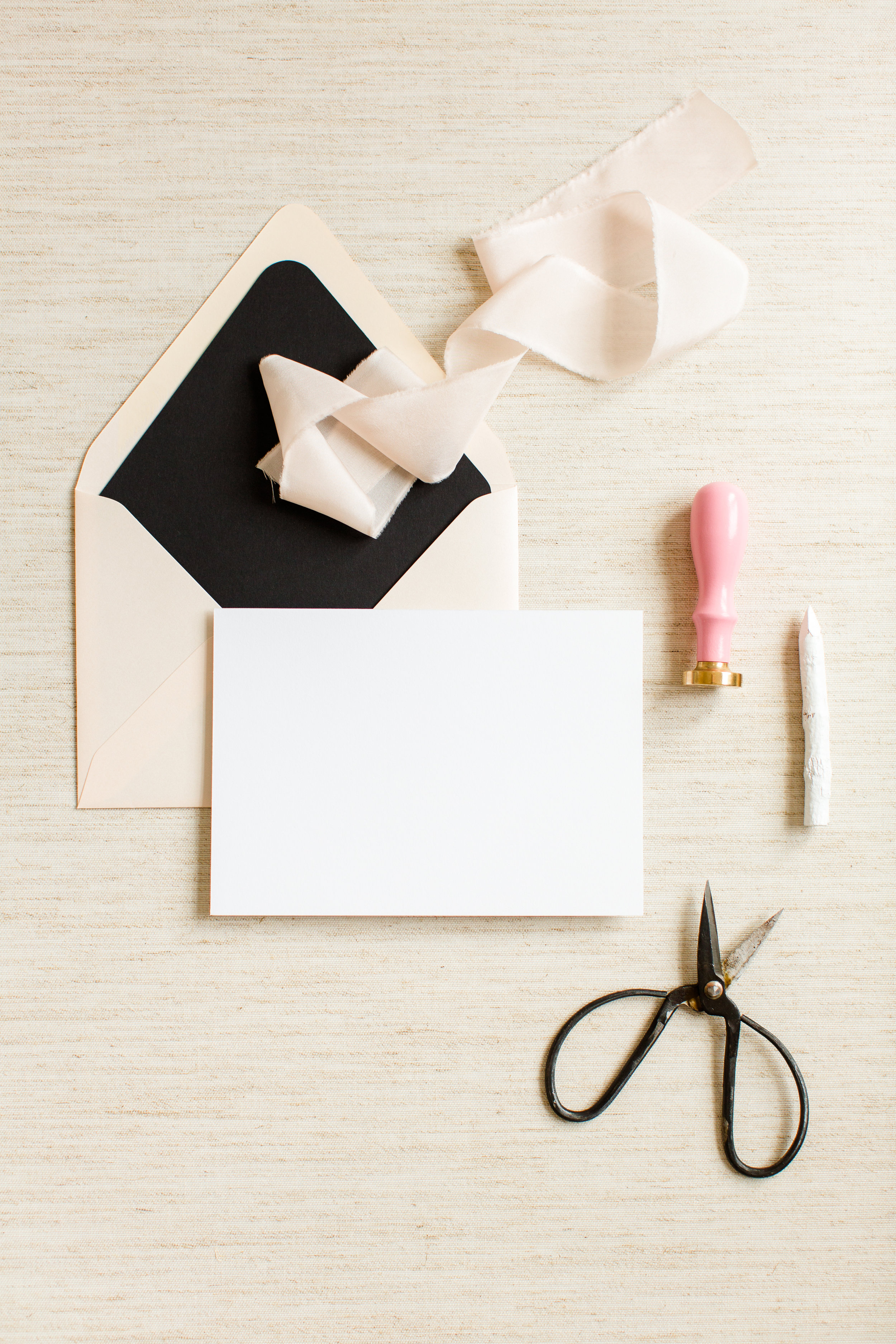 blank white note card with blush envelope and black envelope liner
