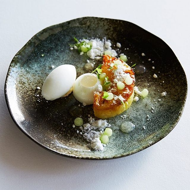 Caramelised pineapple with lime and rosemary sorbet and poached meringue