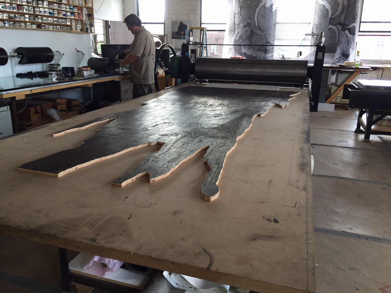 """""""Drip Castle"""" woodblock on the press"""