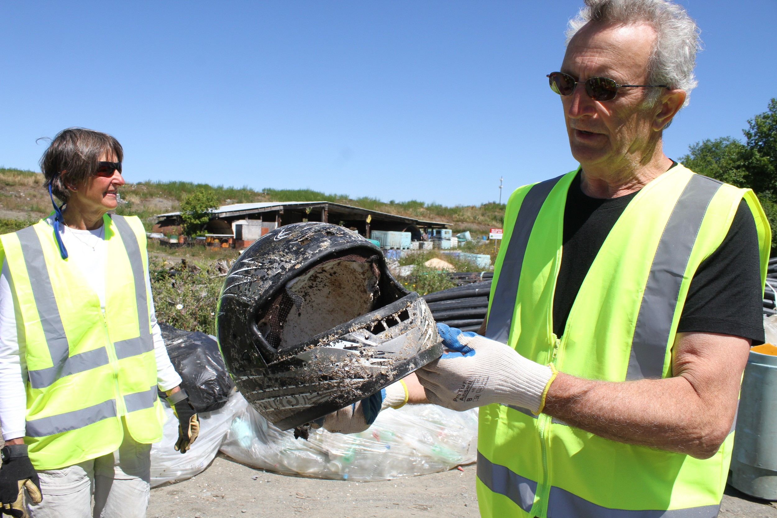 Randy Maillar holds a motorcycle helmet collected on Vancouver Island's west coast from the 2011 Japanese tsunami.  © North Island Gazette.