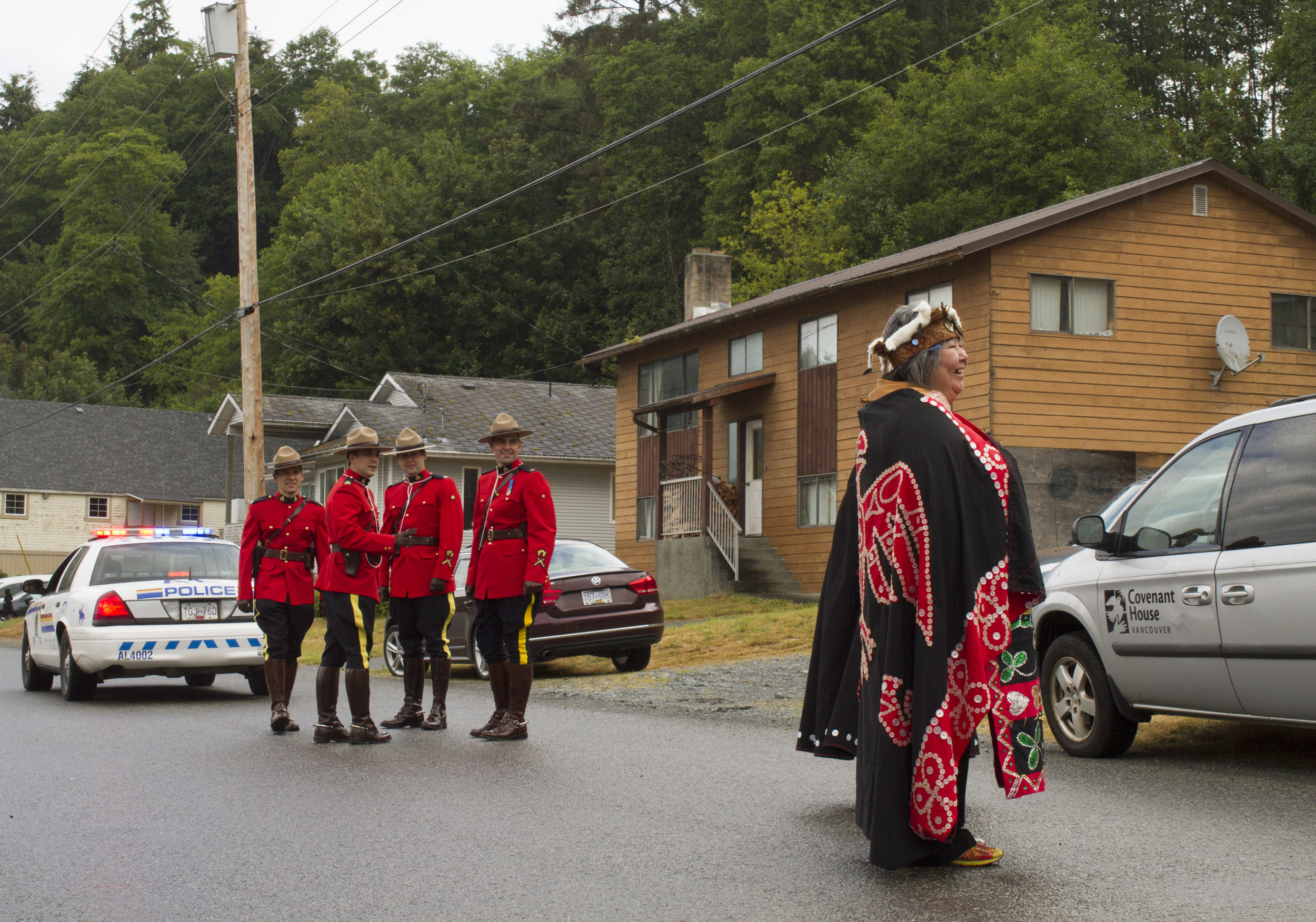 'Namgis First Nation Chief Debra Hanuse and RCMP wait to begin the June Sports parade in Alert Bay, B.C.  © North Island Gazette