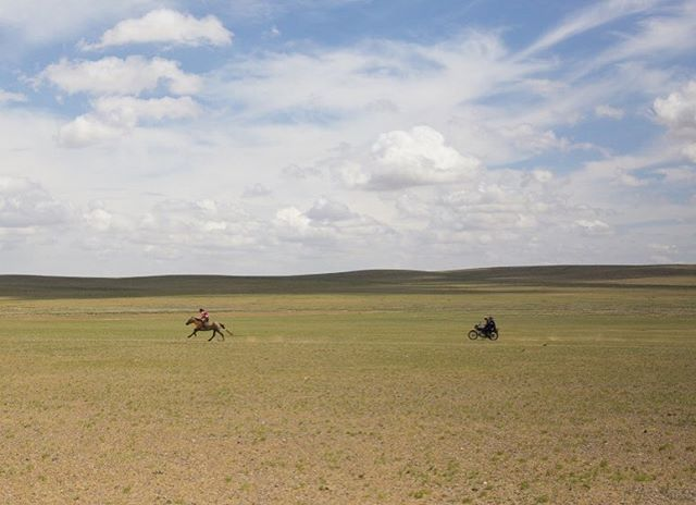 Family activities in Mongolia-9 year old Bujinlkham practices sprinting her horse in the steppes while her dad and sister follow behind. @aljazeera #mongolia #dundgovi #steppes #photojournalism #naadam