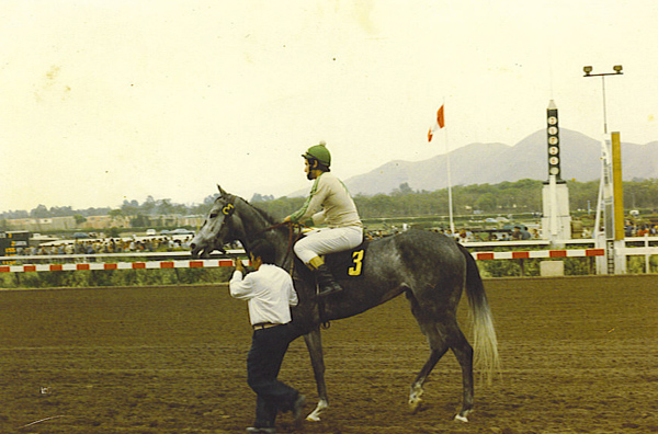Riding at the racetrack in Lima.