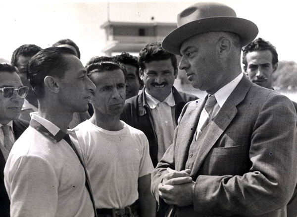 My grandpa as a owner/trainer giving instructions to legend american jockey Eddie Arcaro !! Amazing picture