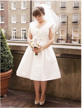 Bride with tea length dress and flyaway style veil.