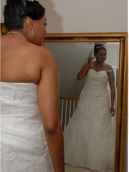 A photo of me in my custom wedding dress in 2008. I worked with this wonderful woman who helped to bring my vision to life. It took a lot of trust, but it worked out great!