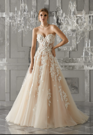 This stunning MoriLee gown will be in our store in late summer.