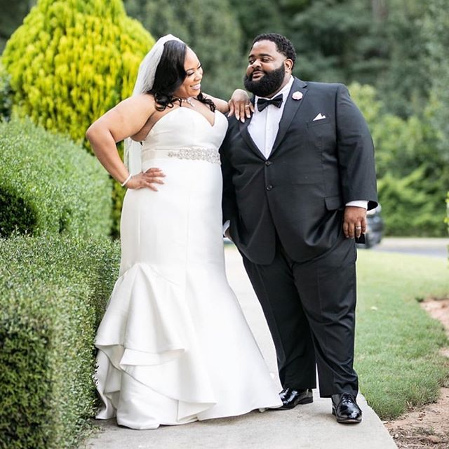 Mr. and Mrs. Johnson looking fly on their BIG DAY!!!⠀ ⠀ Our bride Kemyauna's @maury0912 vision was simple elegance and we think she captured it to a Tee.👌🏾👌🏾👌🏾⠀ ⠀ From her simple satin dress with subtle hints of bling to his classically refined tuxedo, EVERYTHING struck the right note!!⠀ ⠀ Simple + Classic + Refined = Elegance indeed. 😉⠀ ⠀ 📸: @hopeballengerphotography⠀ ⠀ #ChooseLove #BeaLove #BeaYou #BeaU⠀ ⠀ 🌹⠀ .⠀ .⠀ .⠀ #curvyrose #curvyrosebridal #wearecurvyrose #BeLove #BeYou #curvybrides #bodypositivebridal #sizeinclusivebridal #bridalstylist #bridalstyling #curvybridalgowns #2019bride #2020bride #atlantabride #engaged #weddingdresses #weddinggown #bridalgown #bridaldress #atlantaweddings 🌹