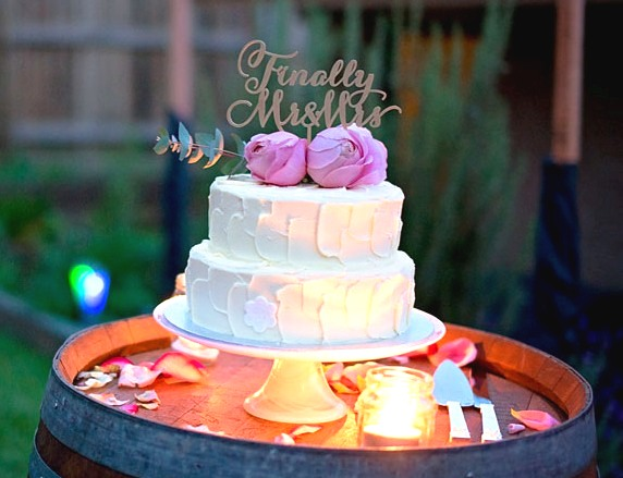 Vanilla Pod 2 tier wedding cake with topper and flowers.JPG