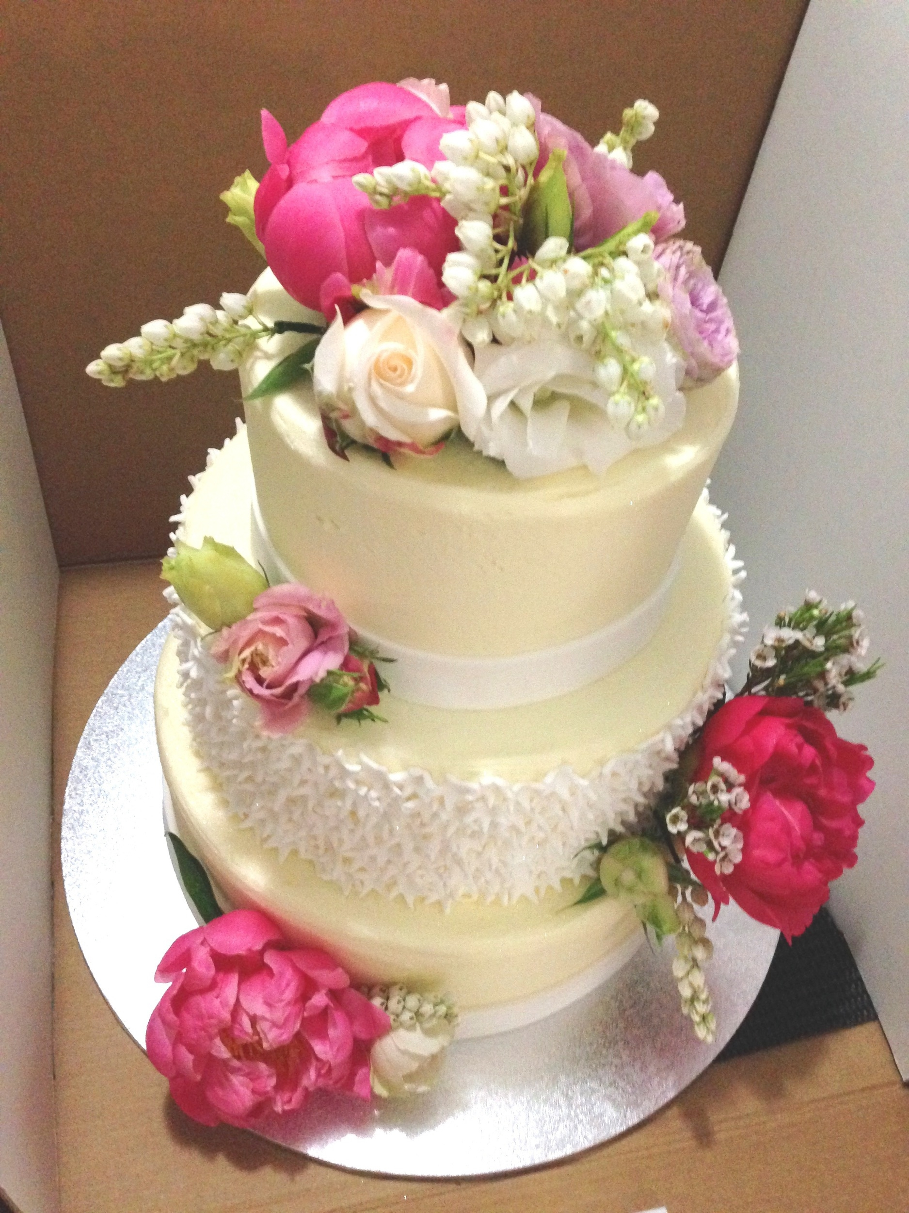 Vanilla Pod 3 tier frosting cake with florals by Bouquet Boutique.JPG
