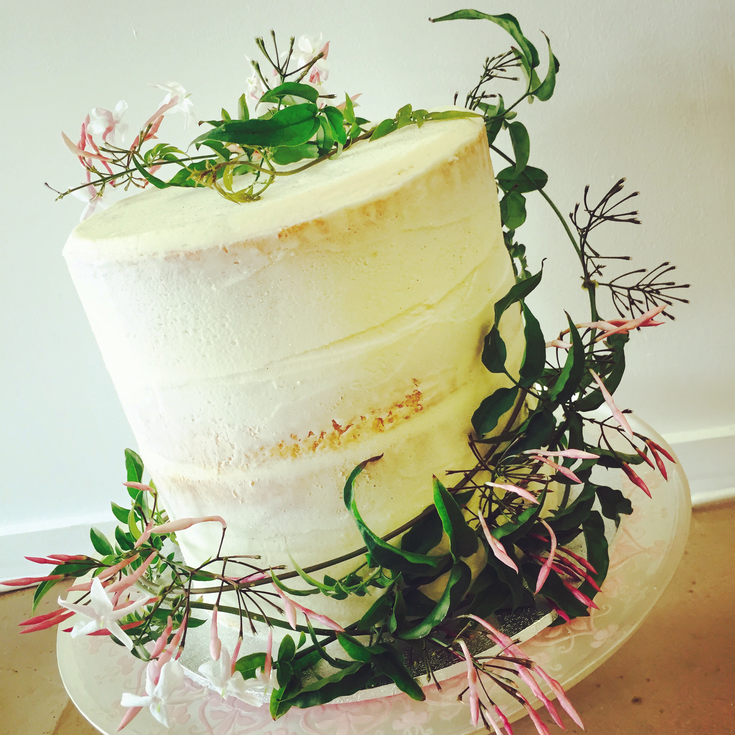 Vanilla Pod Wedding Cake barely frosted with flowers by Bouquet Boutique .JPG