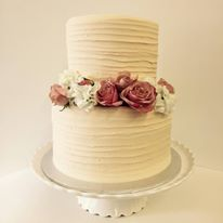 Vanilla Pod ivory frosted wedding cake with flowers.jpg