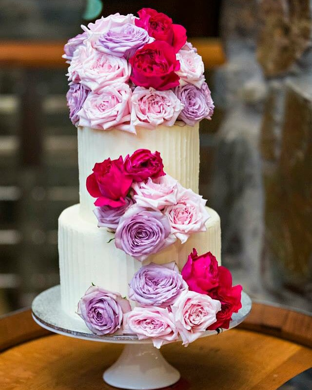 2 tier wedding cake topped with roses by Vanilla Pod.JPG