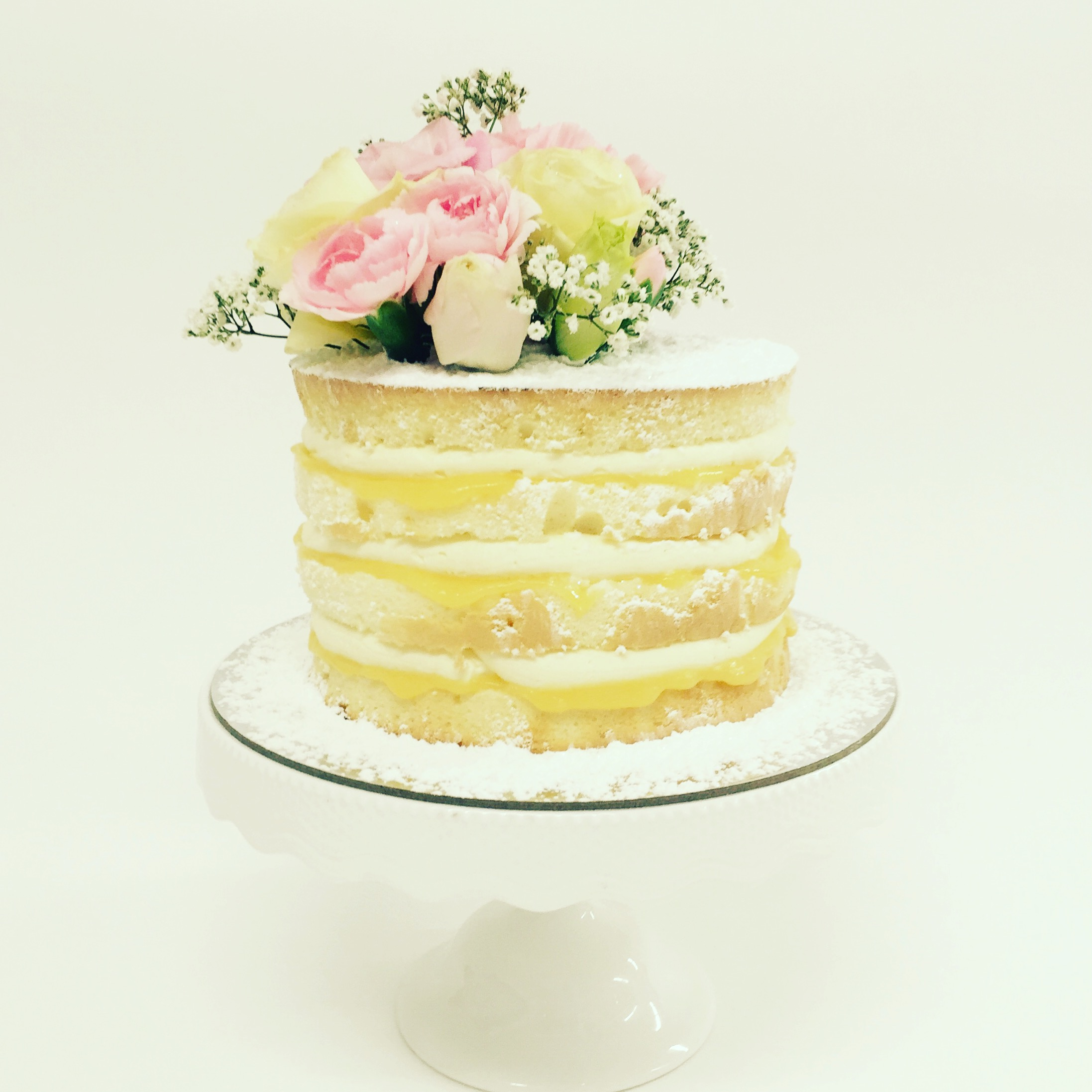 Vanilla pod Engagement Cake topped with fresh flowers Brisbane Naked Layer Cake lemon.JPG