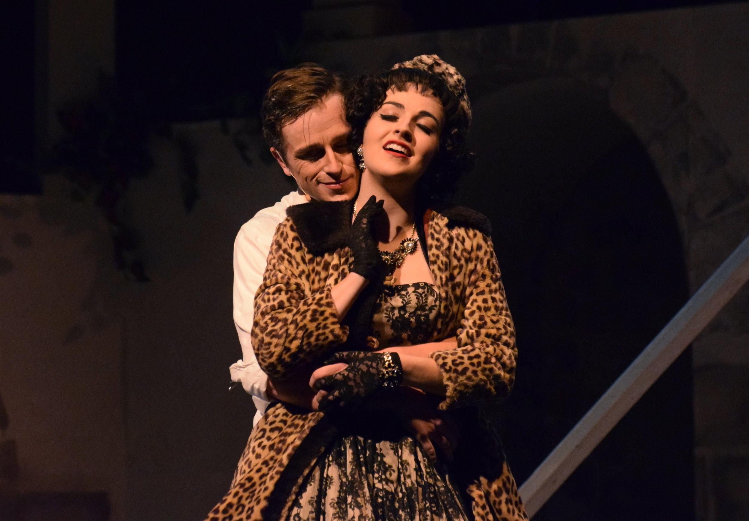 Guido clings to Carla as she says goodbye.